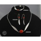 Sterling silver chain necklace with 2 olive leaves holding a natural red coral bead