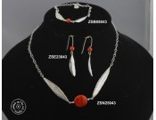 Sterling silver earring with natural red coral bead